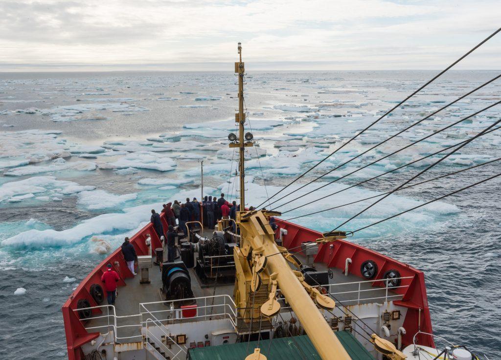 A Canadian Coast Guard Ship navigates through sea ice