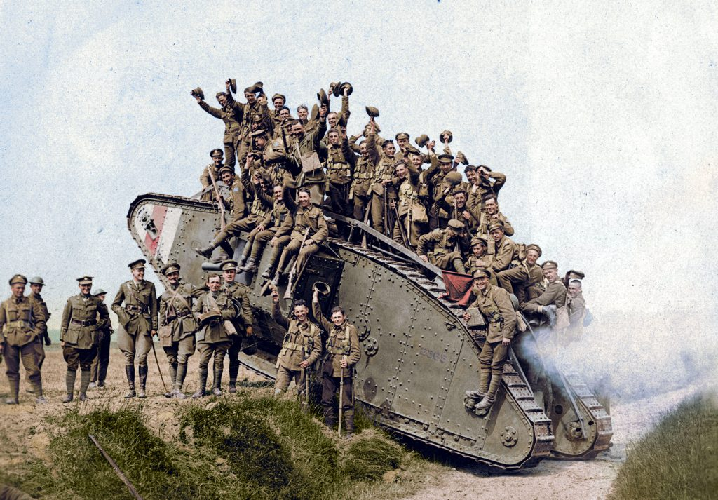 Colourized photo of troops crowded on a tank