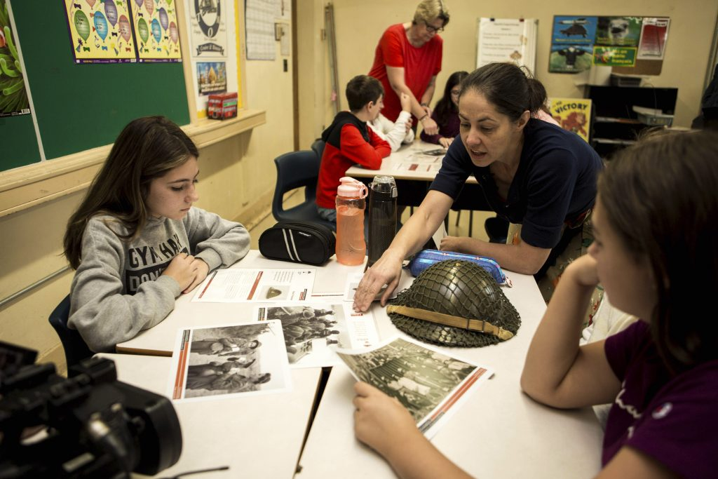 Students looking at artifacts in classroom