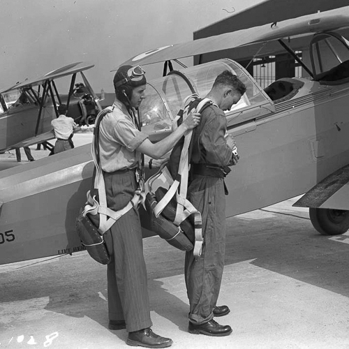 Two air force members prepare for a flight.