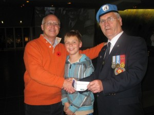Paul Kavanagh with son Darrah and a Veteran. C. Drouin