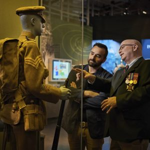A veteran with a Museum visitor