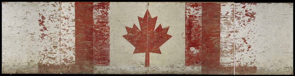 A scuffed wooden panel decorated with a Canadian flag
