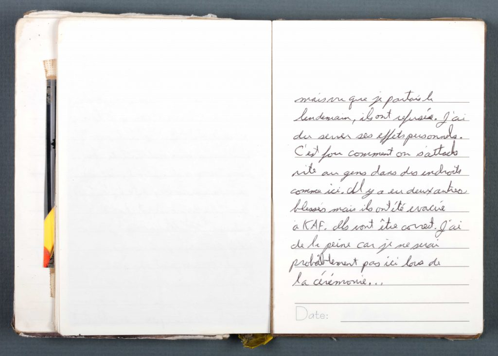 A well-worn diary with handwritten entries